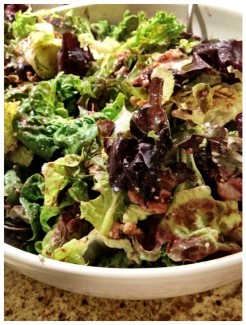 Mixed greens tossed with walnuts, blue cheese and blueberries in a roasted cranberry orange vinagrette